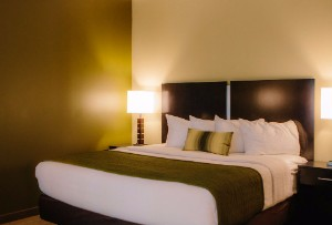 Room with a king bed at The Inn and Suites at Franciscan Square